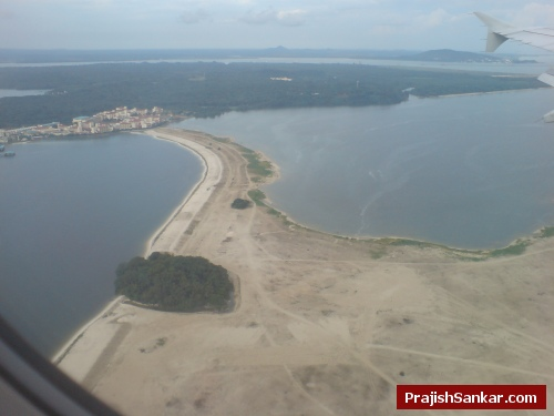 A few seconds before landing. A green island is joined using reclaimed land