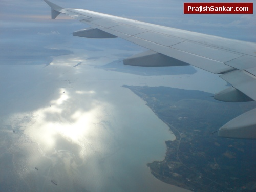 I can see land, sea, ships and suns reflection on water.. a nice view