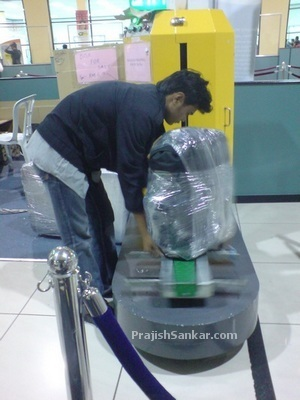 Plastic wrapping service at LCCT airport. It cost me RM8 to wrap my backpack luggage bag.